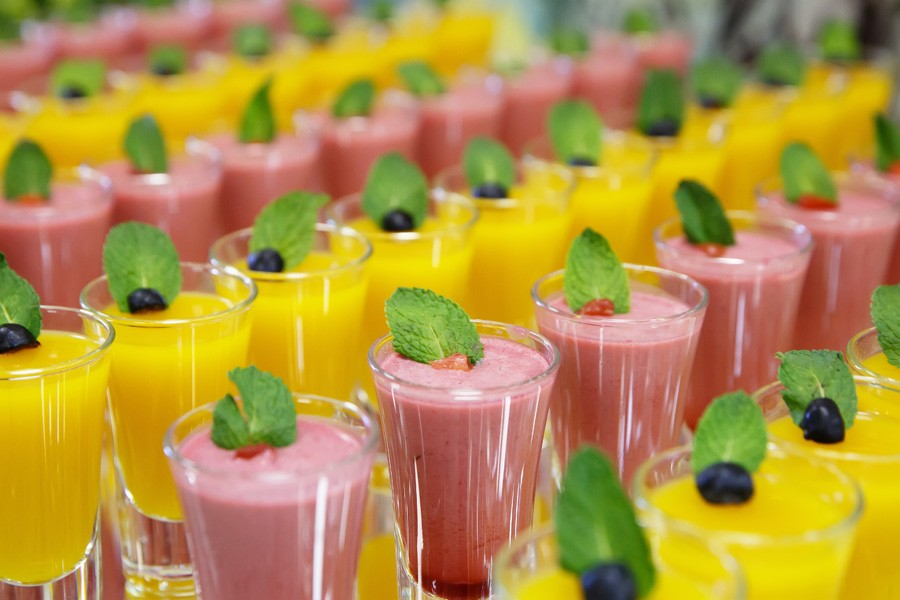 Catring Colored Fruit Mousse Dessert In Glass On Mirror Backgrou