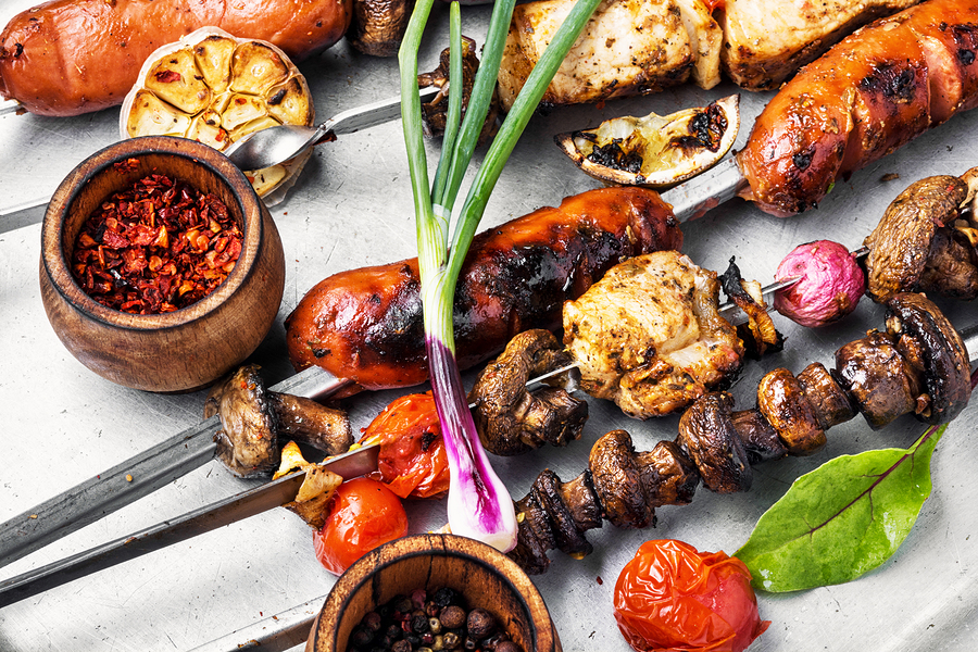 Assortment of grilled dishes, kebabs, sausages and grilled vegetables.Fast food. Eastern food