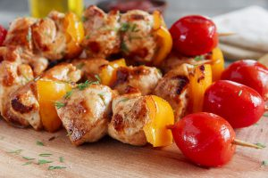 Chicken shish kebab with pepper tomato wooden skewer