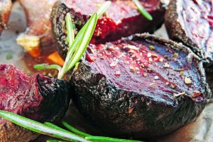 Beetroot baked with garlic and rosemary. Concept of vegetarian food.