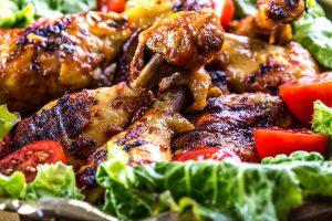 Grilling. Grilled chicken. Grilled chicken legs. Grilled chicken legs, lettuce and cherry tomatoes. Traditional cuisine. Mediterranean cuisine. Tzatziki sauce. Tzatziki dressing. Tzatziki dressing with grilled chicken legs