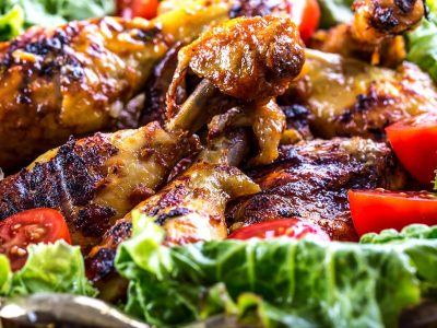 Grilling. Grilled chicken. Grilled chicken legs. Grilled chicken legs, lettuce and cherry tomatoes. Traditional cuisine. Mediterranean cuisine. Tzatziki sauce. Tzatziki dressing. Tzatziki dressing with grilled chicken legs