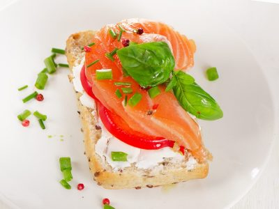 Sandwich with cereals bread and salmon on a plate. Selective focus