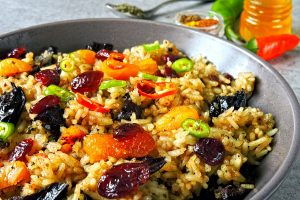 Spicy rice with spices and dried fruits. Vegan bowl. Healthy eating rice with spices. Food for weight loss.