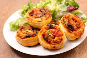 finger food, roll pastry with tomato sauce and olive